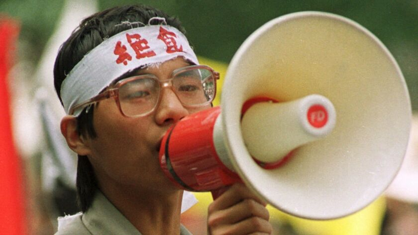 Student protest leader Wang Dan addresses a pro-democracy rally in Beijing's Tiananmen Square in May 1989.