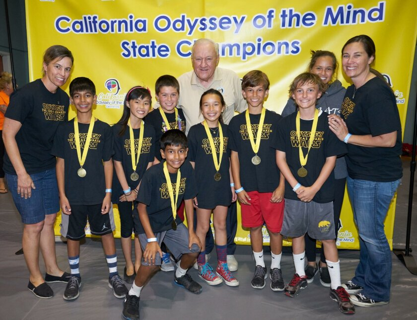 Pacific Rim Elementary took second in its division at the regional competition of Odyssey of the Mind. From left: Coach Kristen Keller, Kiran Sandhu, Mirabel Luo, Marcus MacNeal, Odyssey of the Mind founder Dr. C. Samuel Micklus, Ella Wargo, Camden Keller, Evan Thompson, Assistant Coach Carla Kelliny and Coach Kelly MacNeal. In front: Jayven Sandhu.