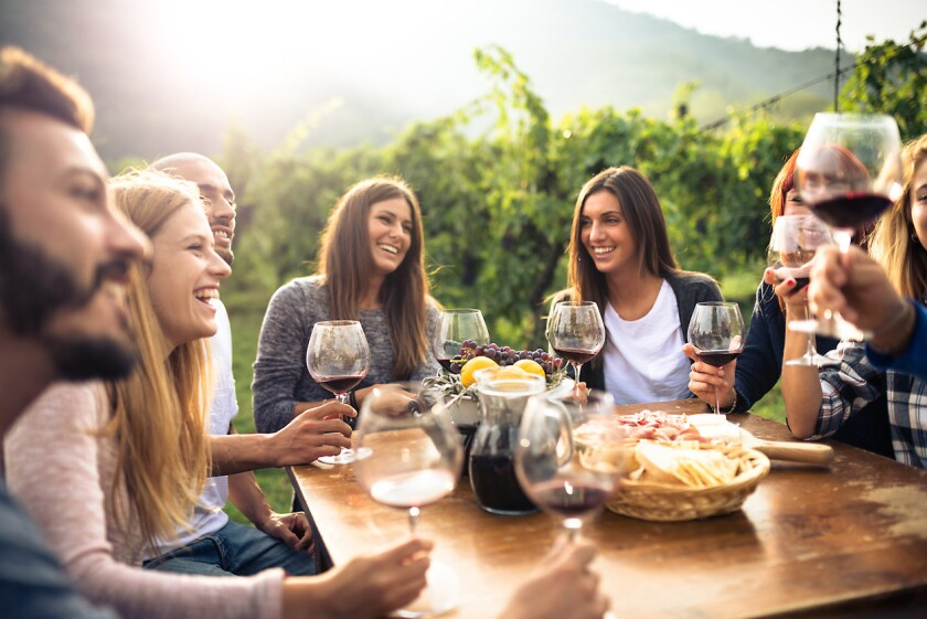 Enjoying outdoor meals with friends during the summer doesn't mean going broke spending money on expensive wine. (iStock)