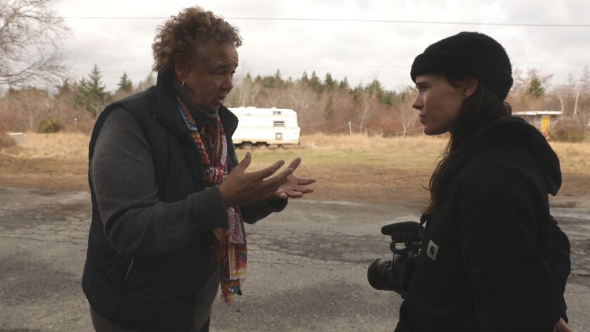 Ellen Page interviews an activist about the long-term effects of a dump in her neighborhood in the documentary 'There's Something in the Water'