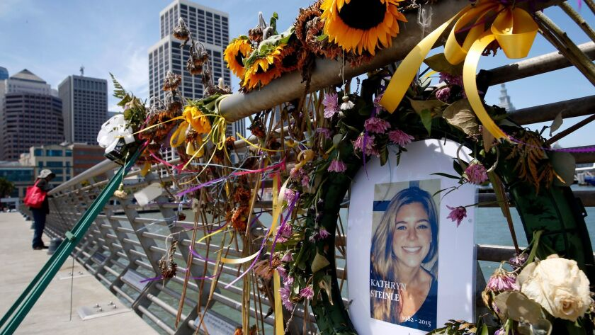 FILE - In this July 17, 2015 file photo, flowers and a portrait of Kate Steinle remain at a memorial