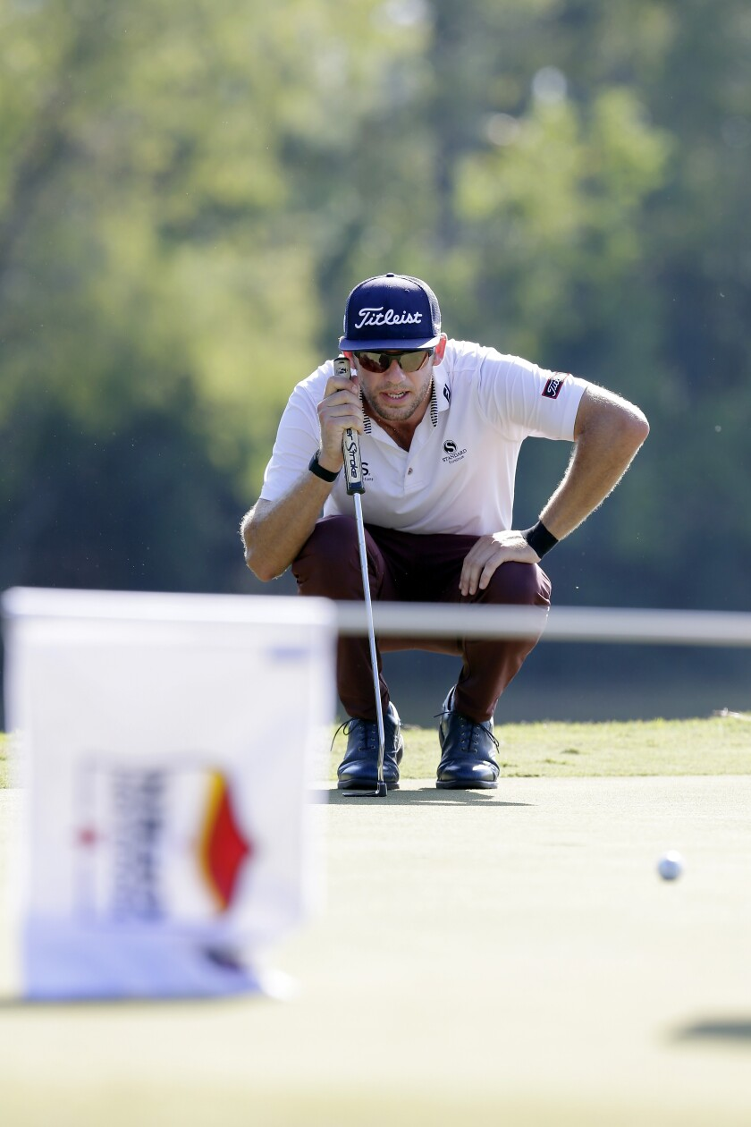 Lanto Griffin lines up his putt on the eighth green during the fourth round of the Houston Open golf tournament Sunday, Oct, 13, 2019, in Houston. (AP Photo/Michael Wyke)