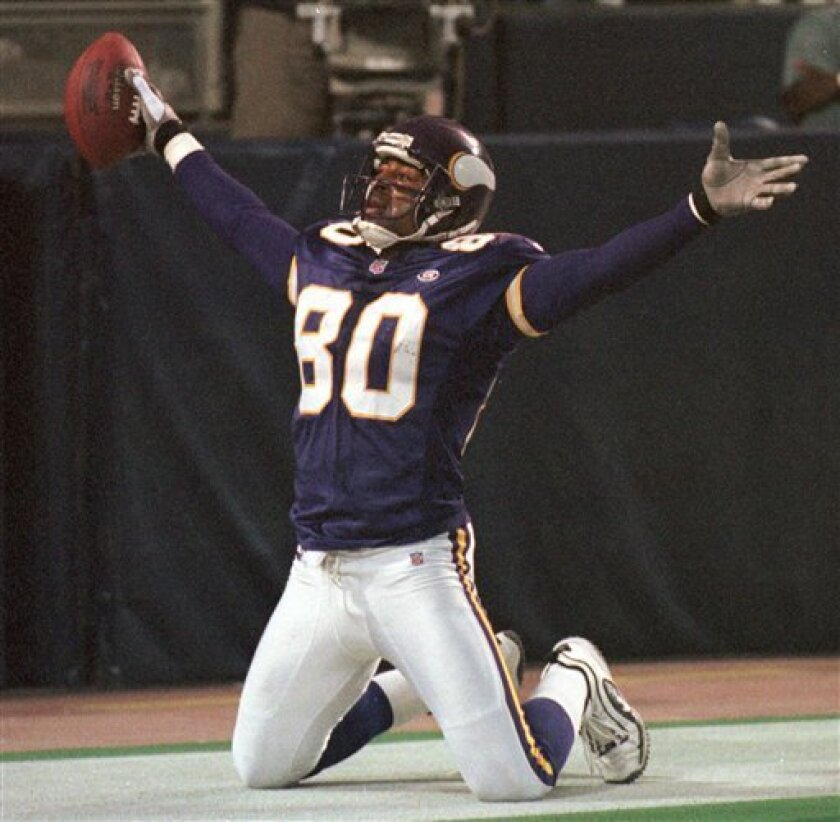 FILE - In this Nov. 8, 1999 file photo, Minnesota Vikings wide receiver Cris Carter (80) celebrates his 6-yard touchdown pass from quarterback Jeff George during the third quarter against the Dallas Cowboys, in Minneapolis. Carter was selected to the Pro Football Hall of Fame on Saturday, Feb. 2, 2