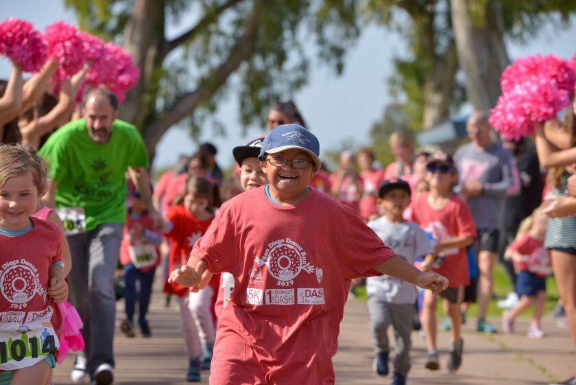Participants run in GiGi's Playhouse San Diego's San Diego Donut Run 2019.