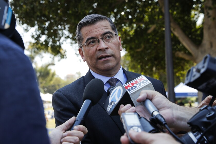 FILE - In this Thursday, Aug. 2, 2018, file photo, California Attorney General Xavier Becerra talks to reporters after a news conference at UCLA. President-elect Joe Biden has picked Becerra to be his health secretary, putting a defender of the Affordable Care Act in a leading role to oversee his administration's coronavirus response. (AP Photo/Jae C. Hong, File)