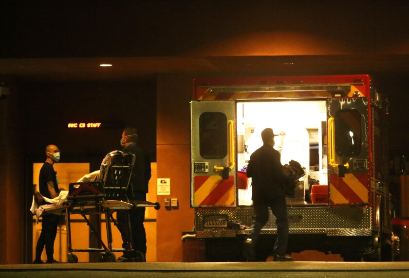 Paramedics bring a patient into the Adventist Health White Memorial hospital in Boyle Heights on Jan. 7.