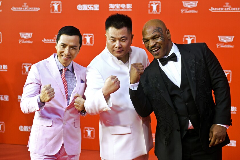 Actor Donnie Yen, left, producer Shi Jianxiang and Mike Tyson pose on the red carpet during the opening ceremony of the 18th Shanghai International Film Festival on June 13, 2015.