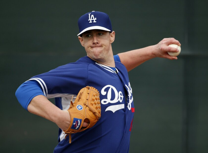 Los Angeles Dodgers pitcher Ryan Buchter throws a pitch during the team's first pitchers and catchers workout Friday, Feb. 20, 2015, in Phoenix. (AP Photo/John Locher)