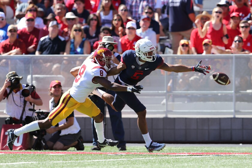 Arizona receiver Trey Griffey can't haul in a pass while being defended by USC defensive back Iman M