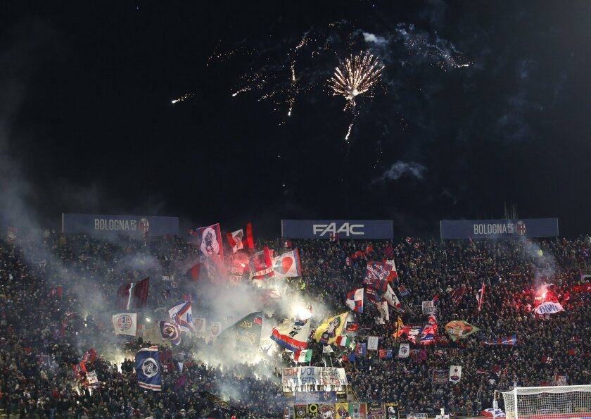 Bologna fans light flares prior to the Serie A soccer match between Bologna and Juventus at the Dall' Ara stadium in Bologna, Italy, Friday, Feb. 19, 2016. (AP Photo/Antonio Calanni)