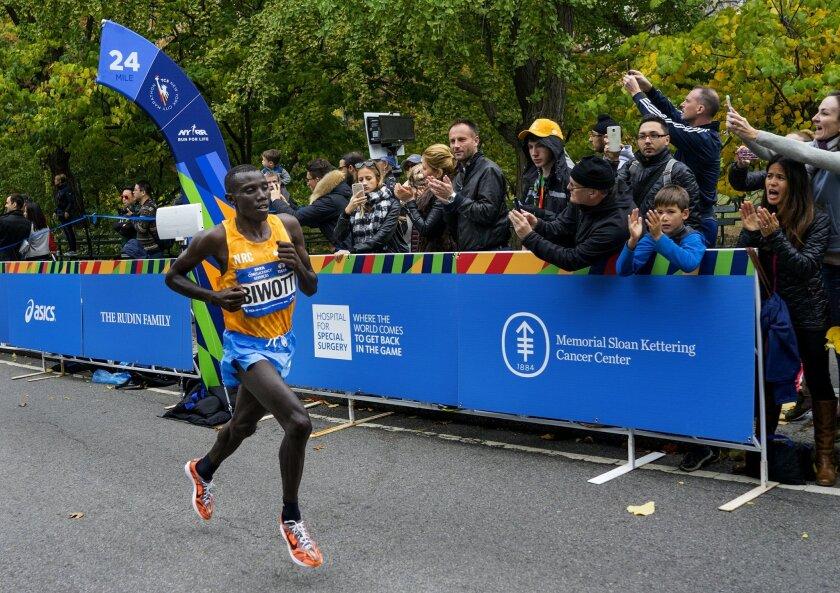 Stanley Biwott of Kenya leads the New York City Marathon at mile 24 in New York Sunday, Nov. 1, 2015. Biwott went on to win. (AP Photo/Craig Ruttle)