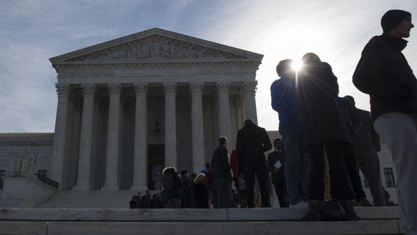 People wait in line outside the Supreme Court in Washington in hopes of admittance for oral arguments.