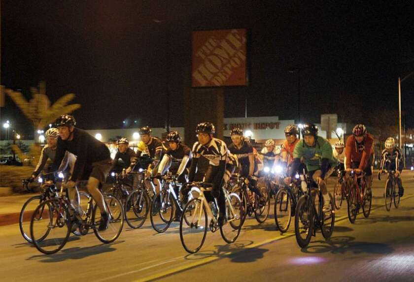 Don Ward, seen above second from left in 2012 leading a night ride in Los Angeles, called off a planned early-morning ride before Sunday's L.A. Marathon after he was informed his group would need a permit for the race.