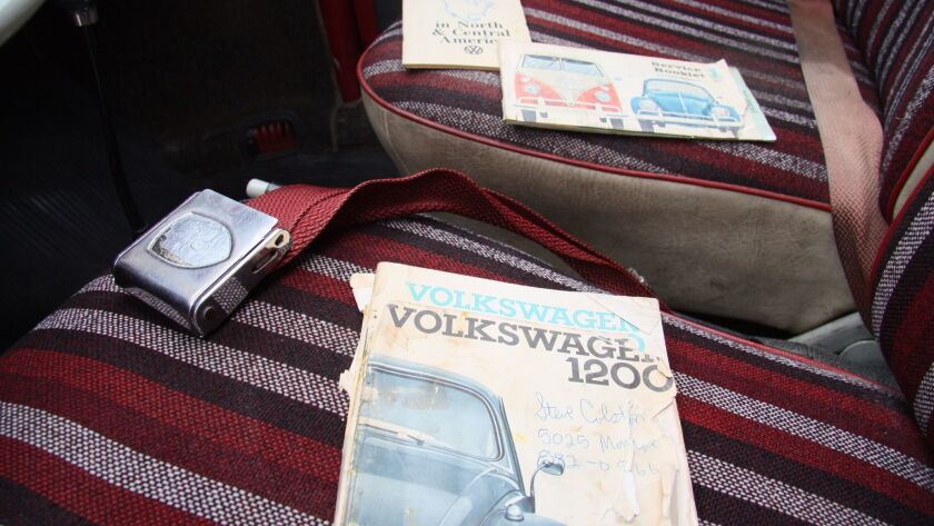 Original manuals and seat belt buckle on front seats.