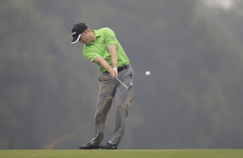 Russell Knox of Scotland hits a shot on the 9th hole during the third round of the HSBC Champions golf tournament at the Sheshan International Golf Club in Shanghai, China Saturday, Nov. 7, 2015. (AP Photo)