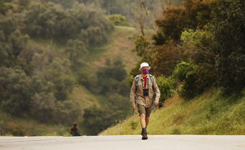 Naturalist Gerry Hans, president of the Friends of Griffith Park, walks along Western Canyon Road in Griffith Park on April 20.