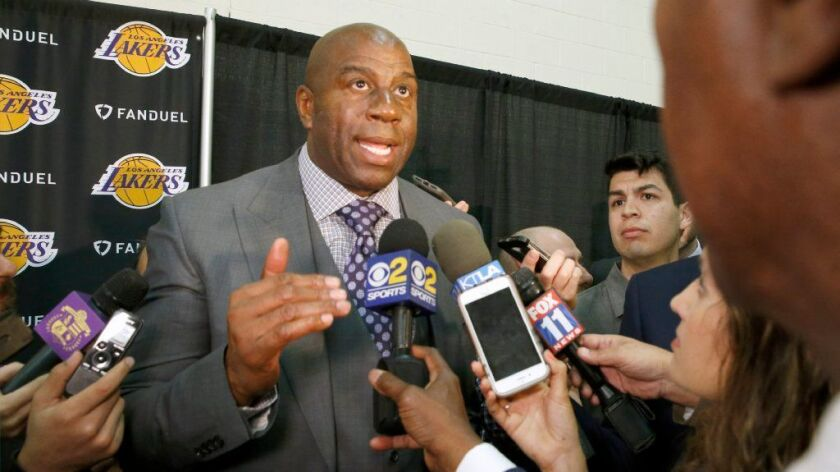 Magic Johnson speaks with members of the media after Rob Pelinka was announced as the new Lakers gen
