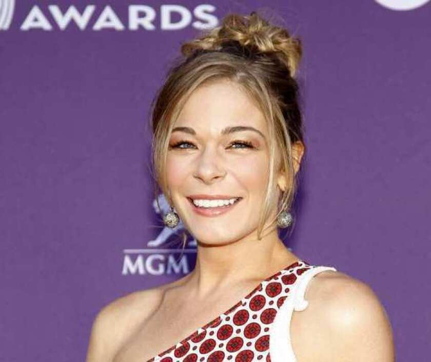 LeAnn Rimes, shown at the Academy of Country Music Awards ceremony in Las Vegas in April, has checked into a rehab center for emotional issues.