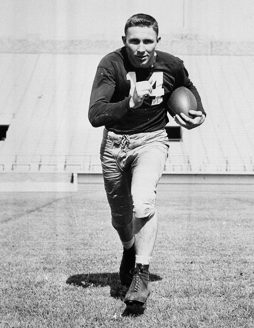 FILE - In this Sept. 10, 1951, file photo, Notre Dame halfback John Lattner runs with the ball in Notre Dame, Ind. Lattner, the 1953 Heisman Trophy winner who helped lead Notre Dame to a 9-0-1 record and a No. 2 ranking in Frank Leahy's final year as coach, has died at 83. His death was confirmed S