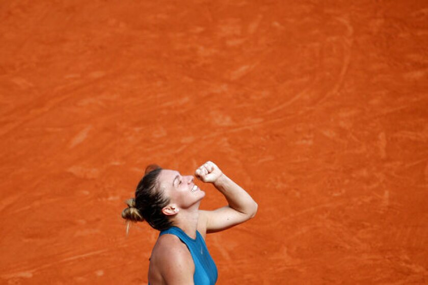 FILE - In this June 9, 2018, file photo, Romania's Simona Halep clenches her fist after defeating Sloane Stephens of the United States during the women's singles final of the French Open tennis tournament at Roland Garros stadium in Paris. (AP Photo/Christophe Ena, File)