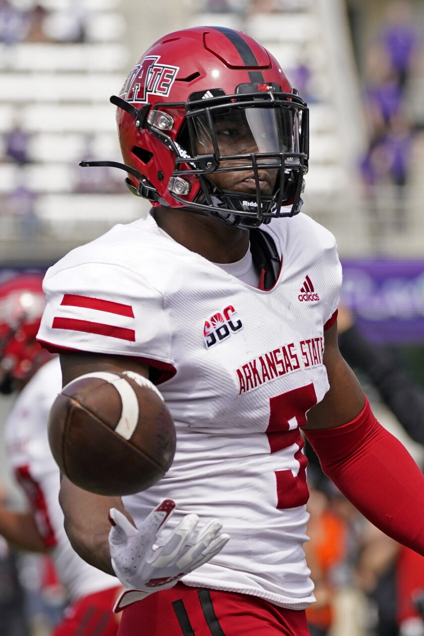 Arkansas State wide receiver Jonathan Adams Jr. celebrates after scoring a touchdown during the second half of an NCAA college football game against Kansas State, Saturday, Sept. 12, 2020, in Manhattan, Kan. (AP Photo/Charlie Riedel)