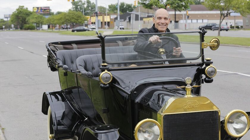 Geoffrey Baer travels in a Model T on Detroit's Woodward Avenue, the first concrete-paved highway,