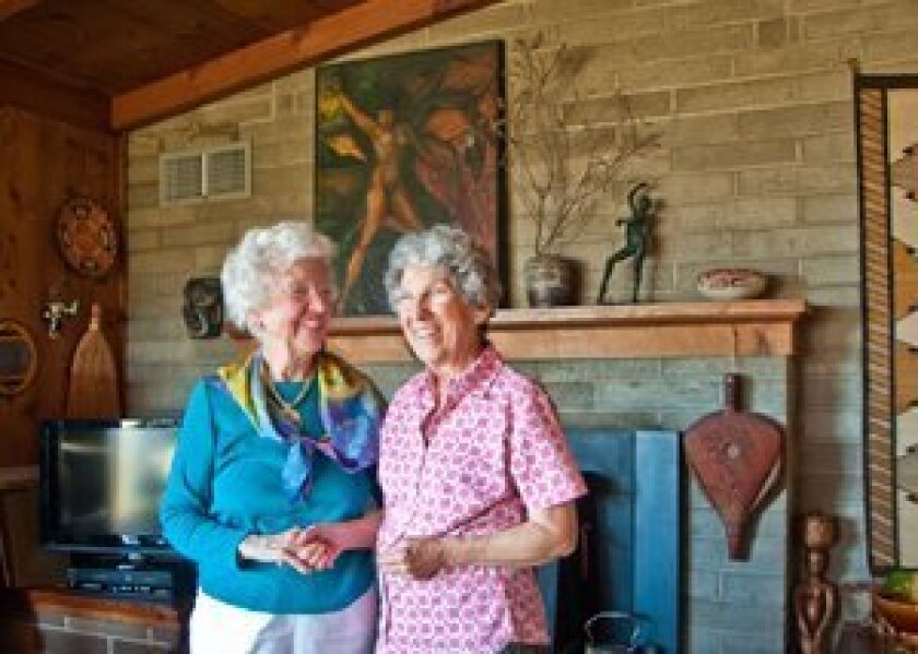 From left: Katie Sanford, 95, stands with her daughter, Lynette, in her Del Mar home of nearly 65 years. Photo: Claire Harlin