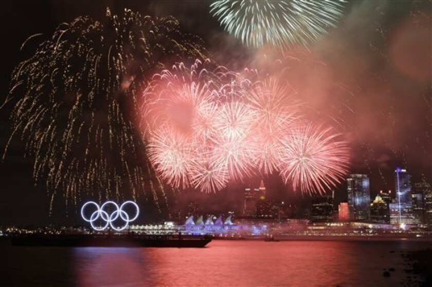 The downtown skyline is seen during the opening ceremonies at the Vancouver 2010 Olympics in Vancouver, British Columbia, Friday, Feb. 12, 2010. (AP Photo/Marcio Sanchez)