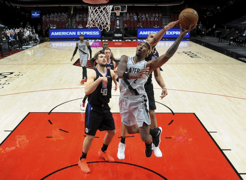 Portland Trail Blazers forward Rondae Hollis-Jefferson, right, drives to the basket on Los Angeles Clippers center Ivica Zubac, left, during the first half of an NBA basketball game in Portland, Ore., Tuesday, April 20, 2021. (AP Photo/Steve Dykes)