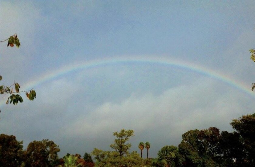 A rainbow formed over the Sorrento Valley shortly after 3 p.m. on Saturday.