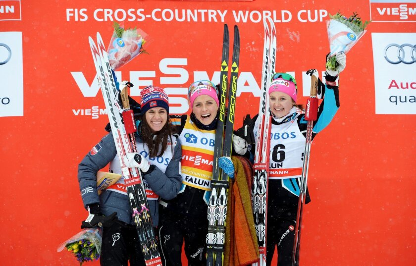 Winner Therese Johaug of Norway, center, celebrates on the podium with second placed Norway's Heidi Weng, left, and third placed Norway's Ingvild Flugstad Ostberg after the women's 5km competition at the FIS Cross-Country World Cup in Falun, Sweden, Saturday Feb. 13, 2016. (Maja Suslin/TT via AP) S