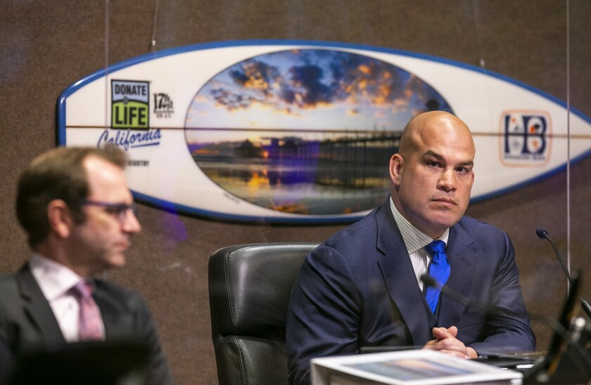 Former Mayor Pro Tem Tito Ortiz, right, resigned from the Huntington Beach City Council on June 1.