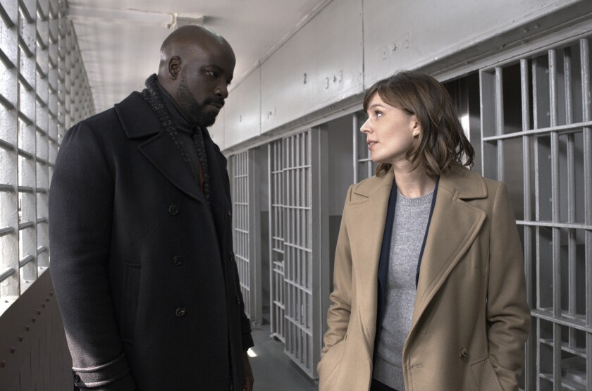 "Mike Colter and Katja Herbers in the pilot episode of ""Evil."""