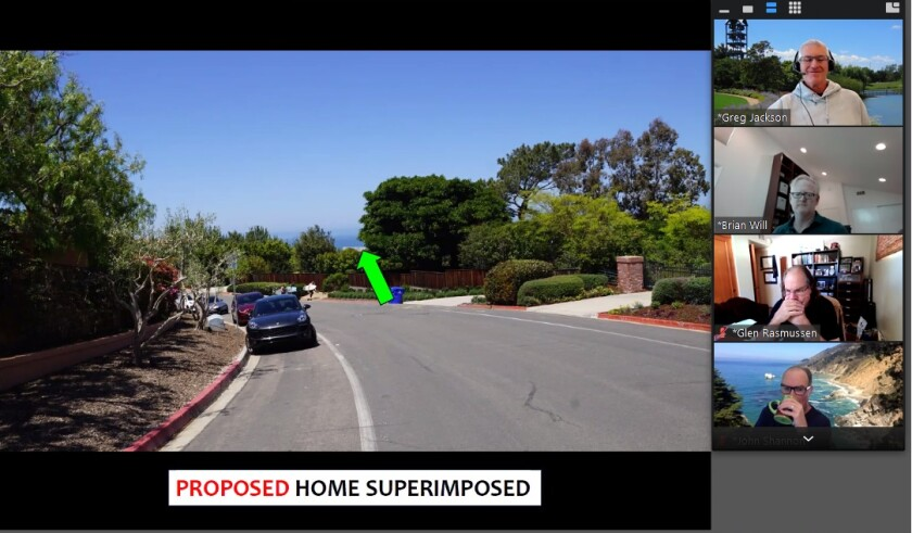 DPR members assess the projected view from the street of an 18,422-square-foot house proposed for 9872 La Jolla Farms Road.