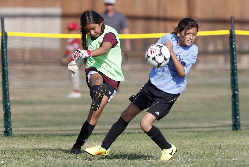 Costa Mesa Sonora Elementary goalie Michelle Villalva, left, clears the ball against Costa Mesa Cali