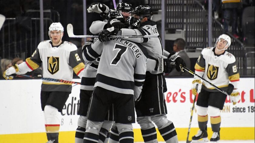 The Kings celebrate on the ice after Tyler Toffoli scored an overtime goal against the Vegas Golden Knights to win their game 4-3 on Sunday.