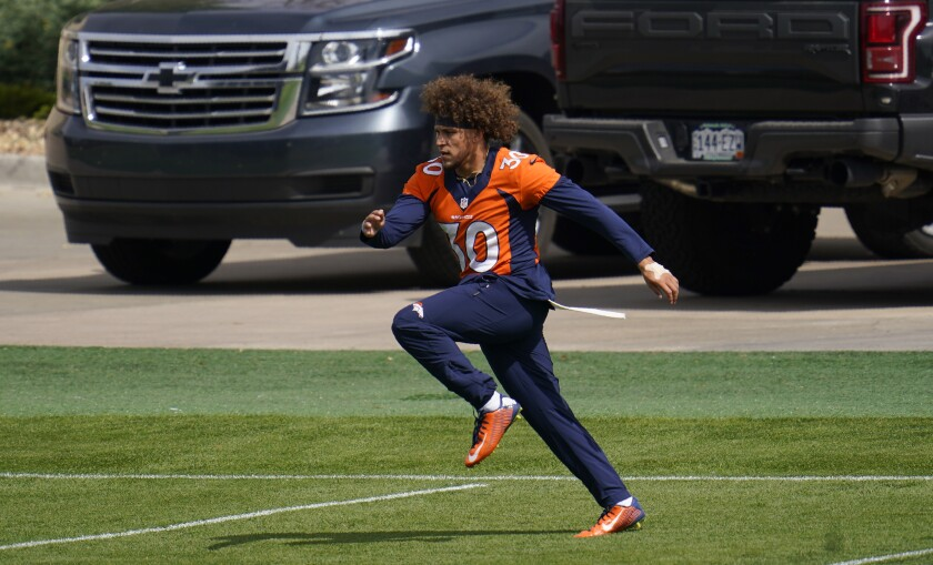 Injured Denver Broncos running back Phillip Lindsay takes part in drills during NFL football practice Thursday, Sept. 24, 2020, in Englewood, Colo. (AP Photo/David Zalubowski)
