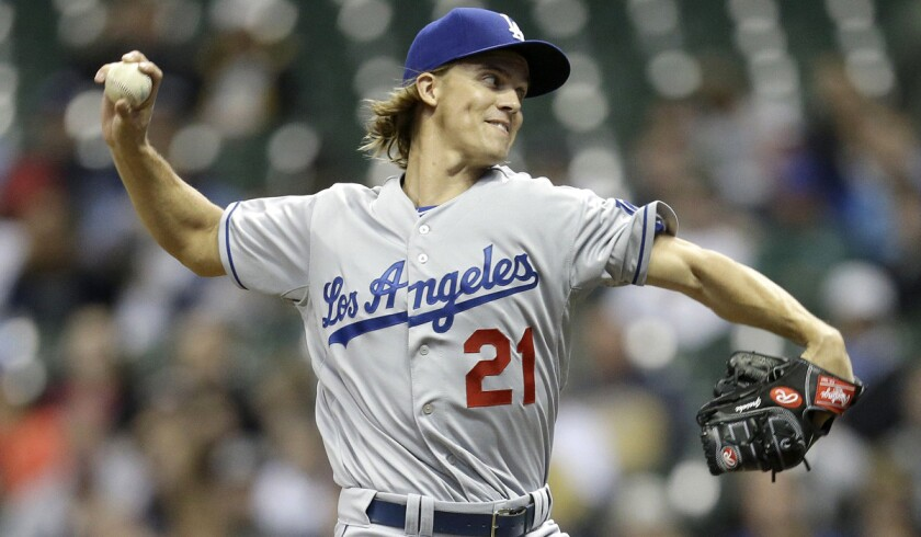 Dodgers' Zack Greinke pitches during a Dodgers 8-2 win over the Milwaukee Brewers on Tuesday.