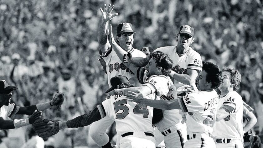 San Diego Padres Steve Garvey (upper left) leaps onto teammates Rich Gossage (54), Terry Kennedy (ce