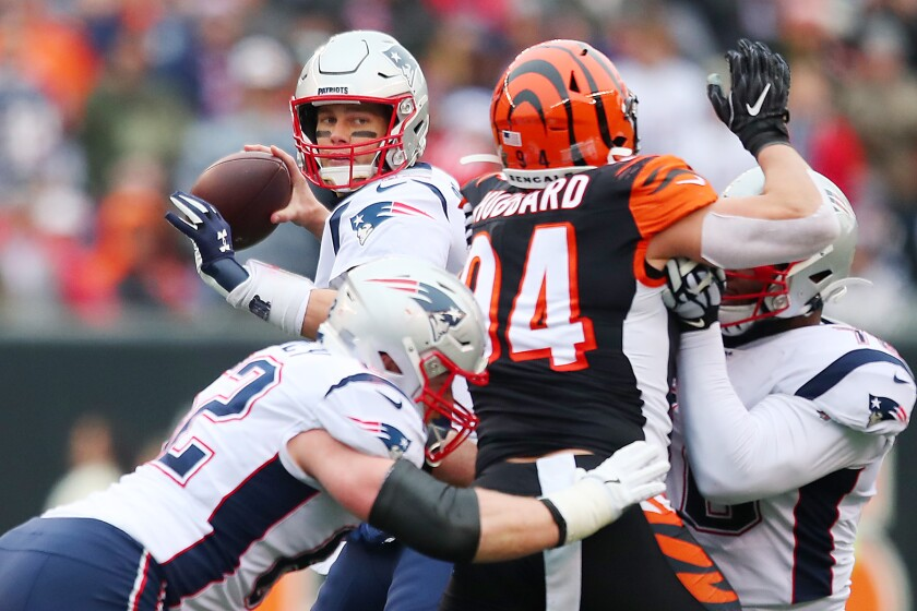 Patriots quarterback Tom Brady throws a pass during the first half of a win over the Cincinnati Bengals on Sunday.