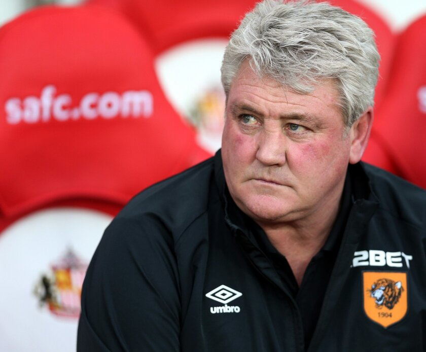 FILE - This is a Friday, Dec. 26, 2014 file photo of  Hull City's manager Steve Bruce as heawaits the start of their English Premier League soccer match between Sunderland and Hull City at the Stadium of Light, Sunderland, England. Hull will play against Sheffield Wednesday in the Championship play