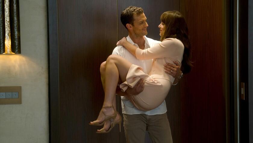 "(L-R) - JAMIE DORNAN and DAKOTA JOHNSON return as Christian Grey and Anastasia Steele in ""Fifty Shad"