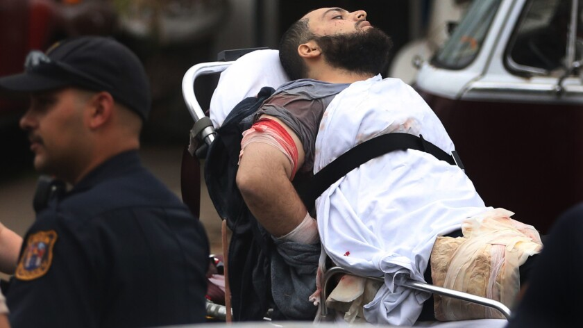 Ahmad Khan Rahami is taken into custody after a shootout with police.