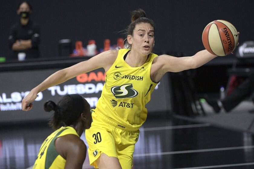 Seattle forward Breanna Stewart saves a ball from going out of bounds by tipping it to guard Jewell Loyd.
