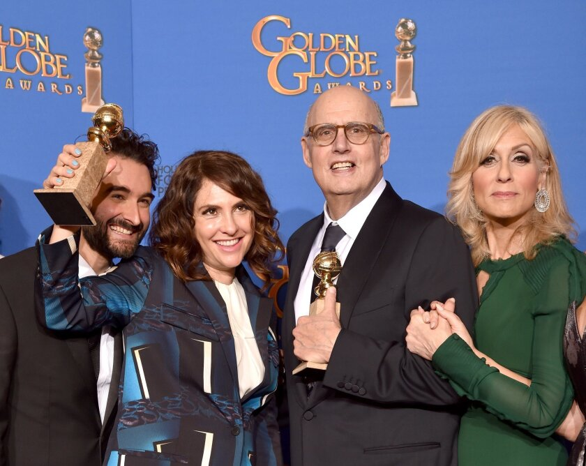 """Actor Jay Duplass, left, writer/producer/director Jill Soloway, and actors Jeffrey Tambor and Judith Light of Amazon's """"Transparent"""" at the 72nd Annual Golden Globe Awards."""
