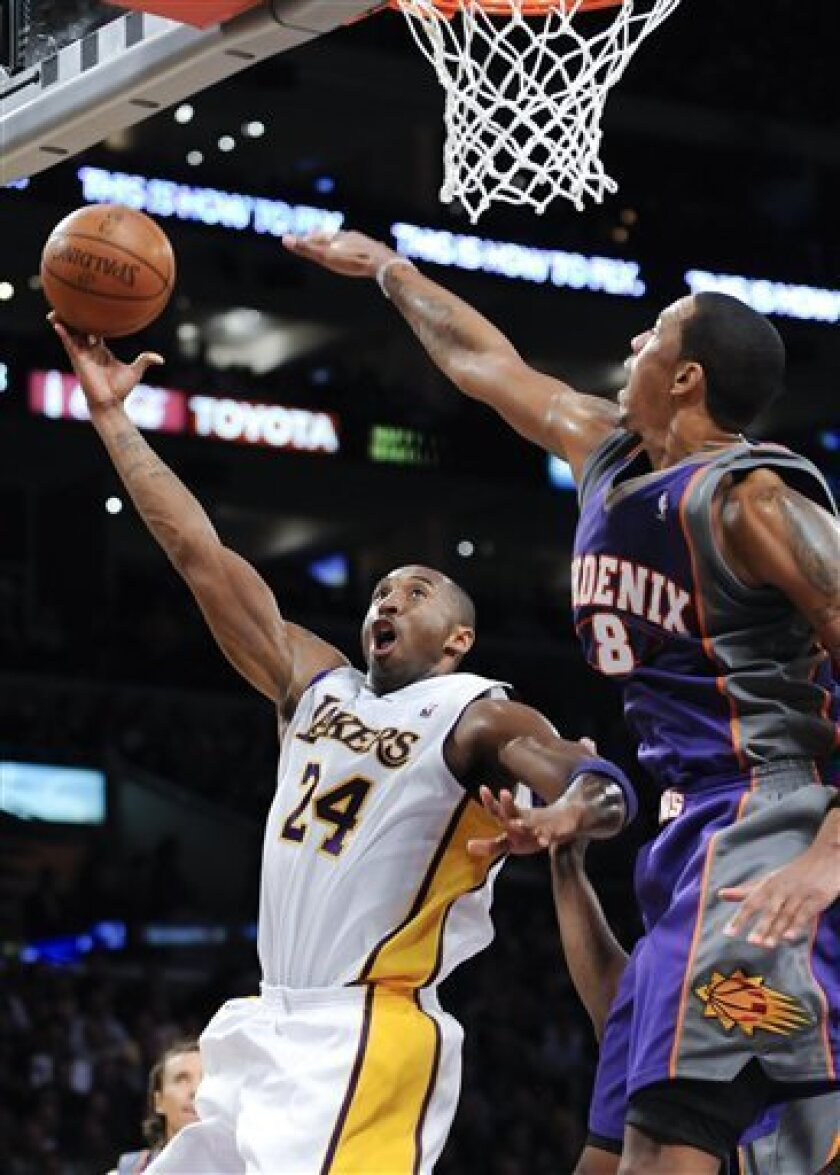 Los Angeles Lakers guard Kobe Bryant (24) shoots over Phoenix Suns center Channing Frye (8) for a basket in the first half of a NBA basketball game, Sunday, Dec. 6, 2009, in Los Angeles. (AP Photo/Gus Ruelas)