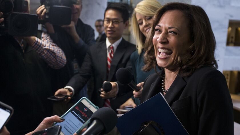 Sen. Kamala Harris speaks to reporters last month after a briefing on Capitol Hill. The junior senator from California appears to be putting in place final preparations for a run for the Democratic presidential nomination.