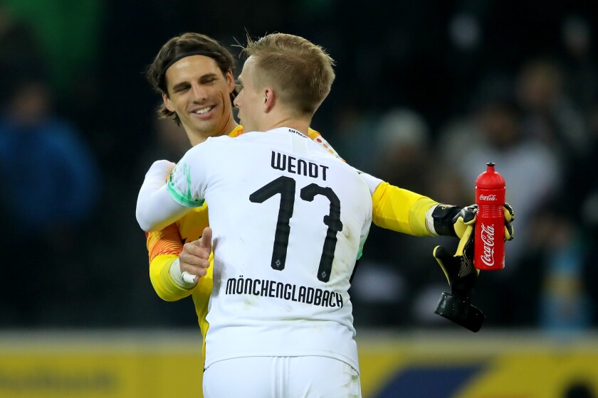 lr Yann Sommer and Oscar Wendt (17) of Moenchengladbach celebrate after beating FSV Mainz 05 on Jan. 25 at Borussia-Park.