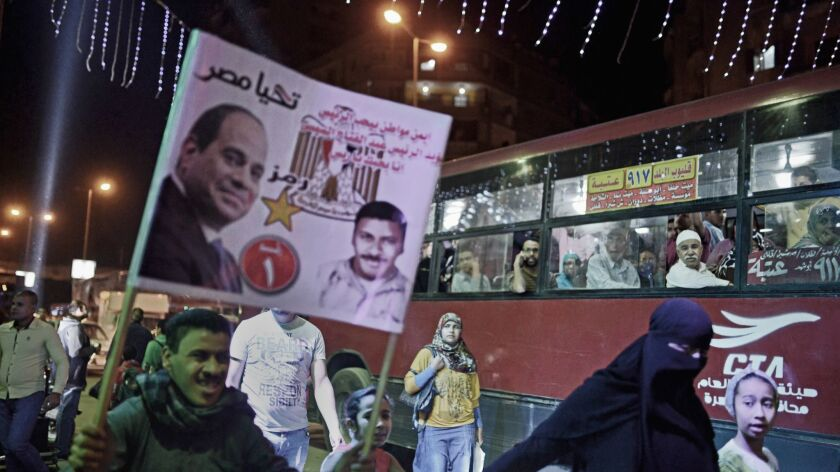 Supporters of Egypt's incumbent president, Abdel Fattah Sisi, head to a political gathering in Cairo's working-class district of Shubra on March 21, 2018.