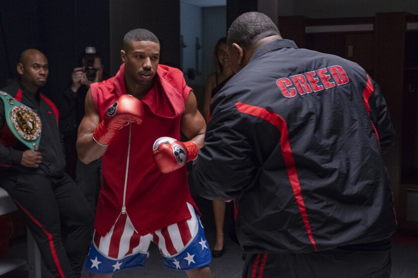 C2_09180_RC2 (left) Corey Calliet as Creed Cornerman and (ctr) Michael B. Jordan stars as Adonis Creed in CREED II, a Metro Goldwyn Mayer Pictures and Warner Bros. Pictures film. Credit: Barry Wetcher / Metro Goldwyn Mayer Pictures / Warner Bros. Pictures © 2018 Metro-Goldwyn-Mayer Pictures Inc. and Warner Bros. Entertainment Inc. All Rights Reserved.